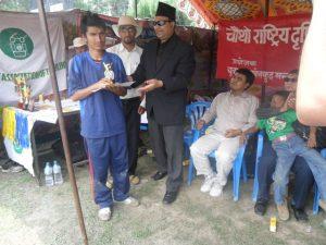 Abilis facilater Mr. Birendra raj Pokheral awarding Lumbini's B2 Player Ram Prasad Poudel Man of the match trophy