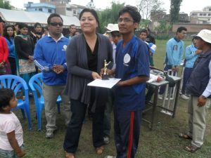 Awarding man of the match Troffy to lumbini's B3 Captain Khimananda Gaire by Punam Karmcharya