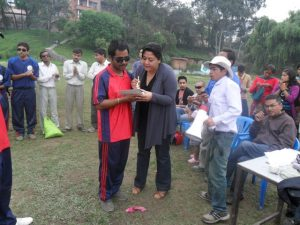 Valley's B1 Player Bhawitsya Jha Receiving Man of the Match from Punam Karmacharya