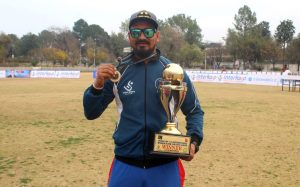 Nepal's coach Rijan Prazoo with the trophy