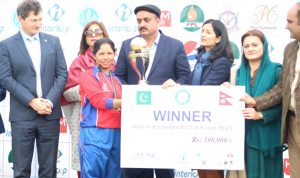 Nepal's captain Bhagwati Bhattarai receiving the winner's trophy