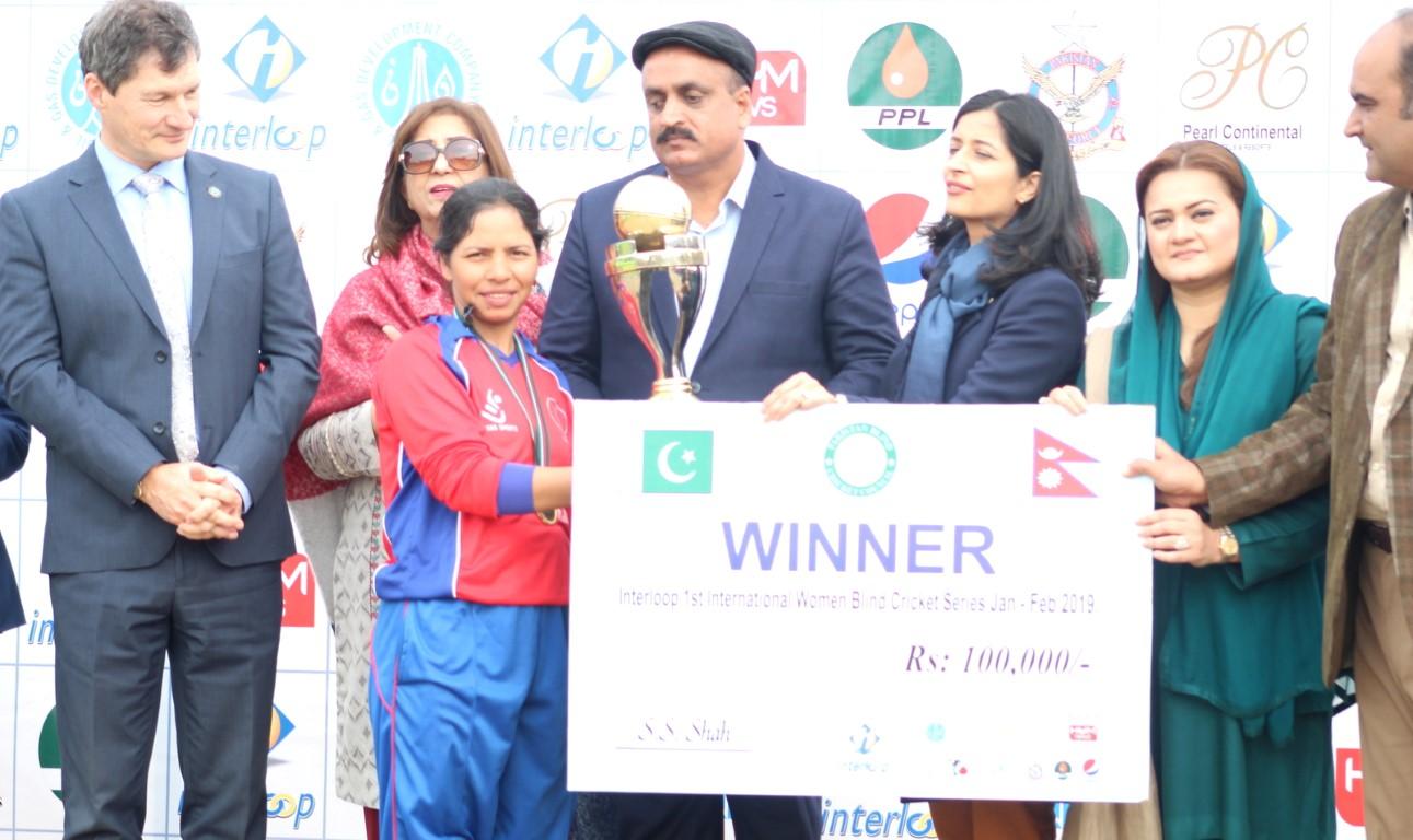 Nepal's captain Bhagwati Bhattarai receiving the winner's trophy