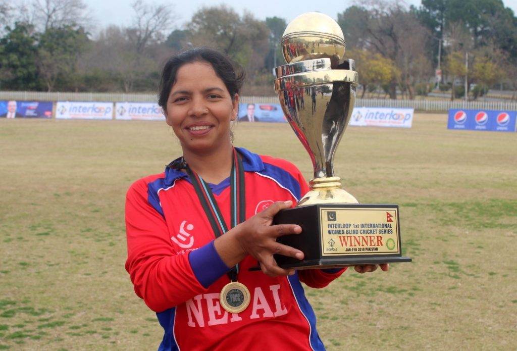 Captain Ms. Bhagwati Bhattarai of Nepali Blind Women Cricket team holding the winning trophy.