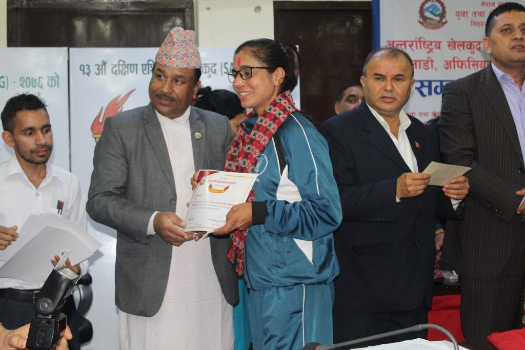 Minister of Youth and Sports awarding Blind Women Cricketers