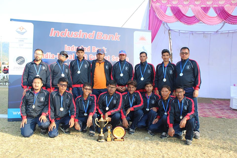 Nepali b;lind cricket team with the first runner up trophy in Kanpur